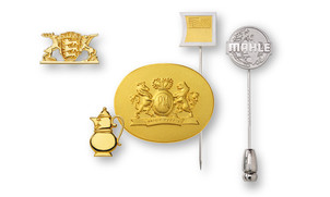 lapel pins made of precious metal cast or embossed