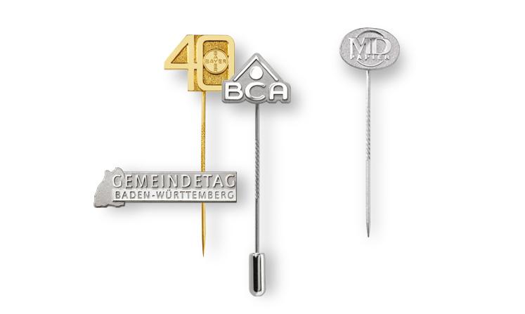 Lapel pins made of embossed precious metal