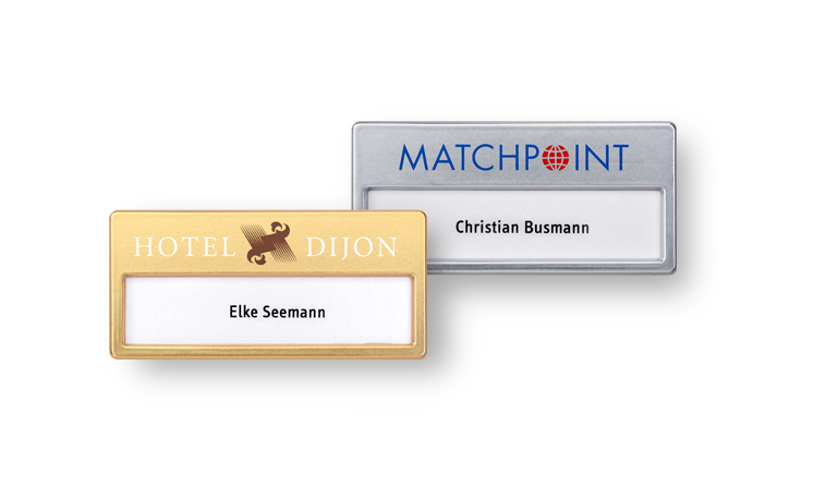 Plastic name badges with metallic finishes