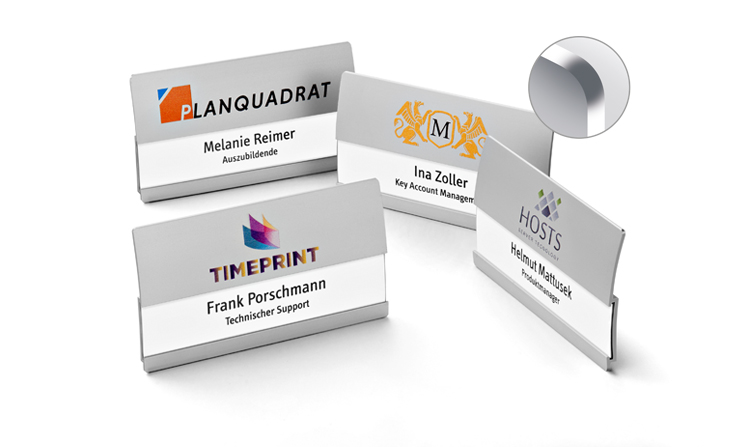Curved metal name badges with space for two lines