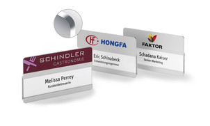 Metal name badges with rounded corners