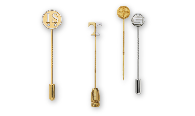 Embossed lapel pins and pin badges made of precious metal