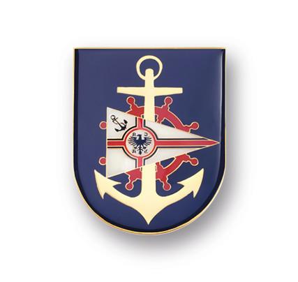Plaketten und Embleme, Prägung mit Emaille