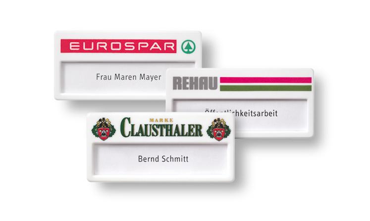 White plastic name badges