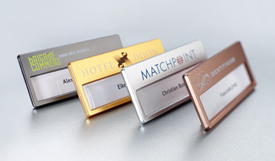 Name badges with metallic surface