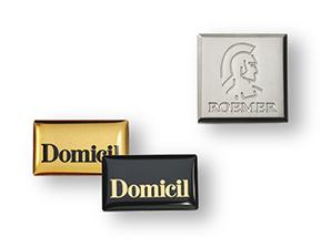 Emblemi, targhe ed etichette di marca