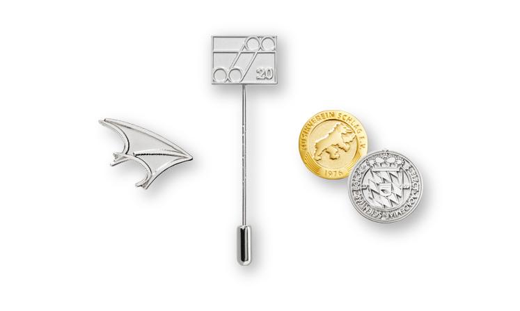 Spille e distintivi in metallo in versione lucido-opaca