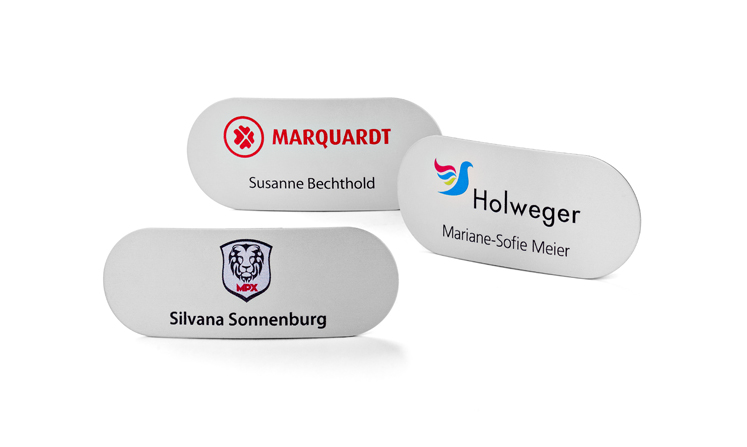 Name badges made of metal with rounded corners