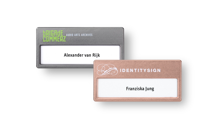 Name badges made of plastic with metallic finishes